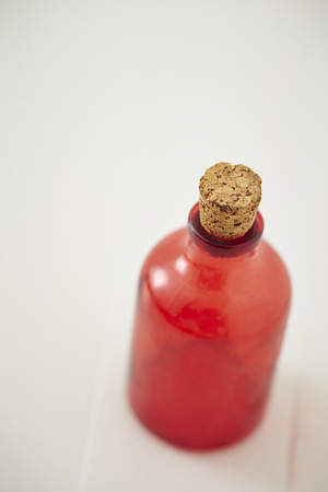 samll: Small red bottle