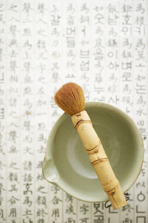Brush and tea cup