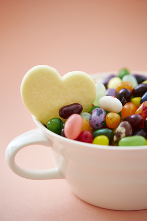 jelly beans: Heart cookie with jelly beans in cup