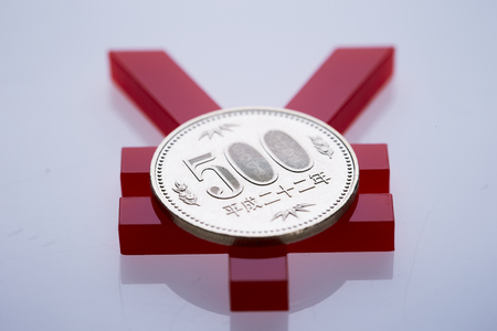 Japanese yen coin and currency symbol Stock Photo