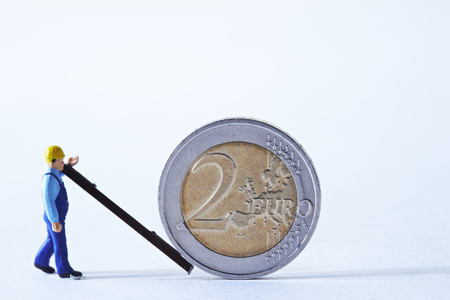 Miniature man with Euro coin Stock Photo - 74491522