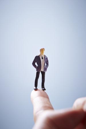 elite: Miniature man on fingertip