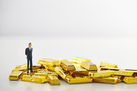 Miniature man with gold bars