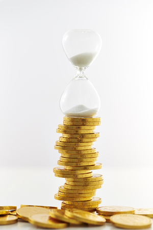 Hourglass with coins