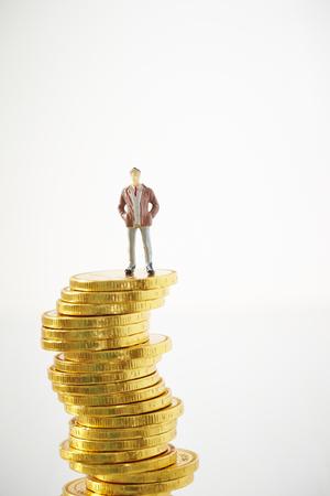 Miniature man on coins