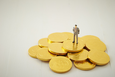 Miniature man with coins