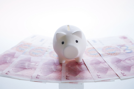 Piggy bank with Chinese RMB banknotes Stock Photo