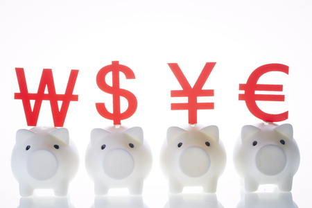 Piggy banks with currency symbols
