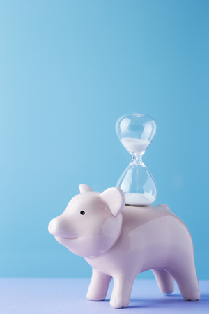 Piggy bank with hourglass
