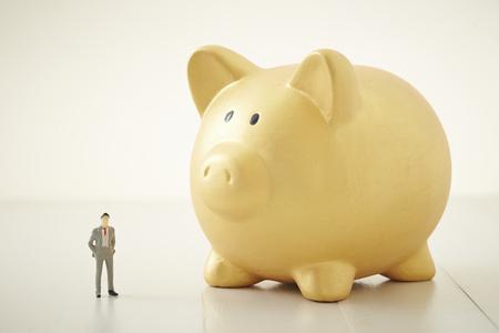 Piggy bank with miniature man