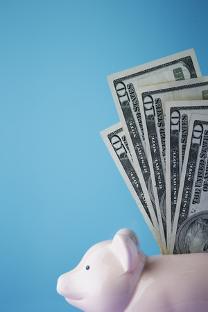 US dollar banknotes with piggy bank Stock Photo
