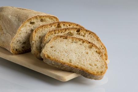sliced bread on cutting board, italian bread Reklamní fotografie