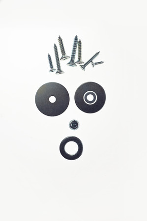 face composed of screws washers and bolts Reklamní fotografie