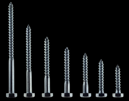 set wood screws isolated on black background
