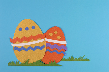 colorful eggs with grass on a blue background
