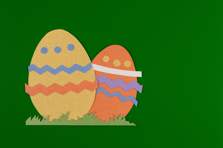 colorful eggs with grass and cut on paper, easter egg on a red background