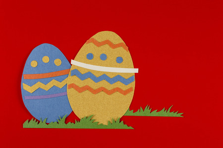 colorful eggs with grass on a red background Reklamní fotografie - 26827860