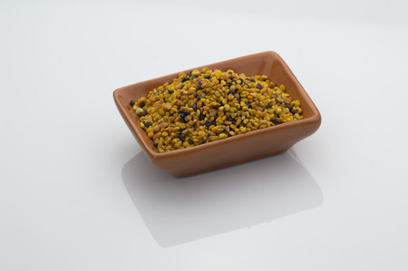 bee pollen grains on withe backgound