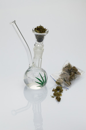 beautiful glass pipe with marijuana on white background Reklamní fotografie