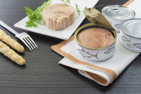 tuna with bread stick and can