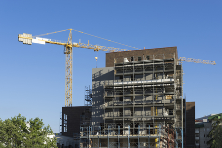scaffolding housing construction with yellow tower crane Reklamní fotografie