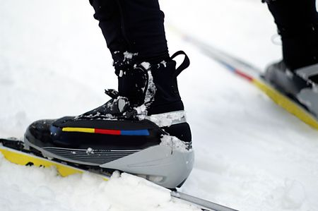 These boots were made for skiing...fast that is. Close up of nordic skating boots, bindings and skis in the snow. Stock Photo