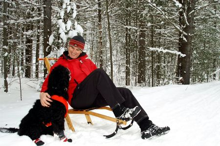 Kicksled team takes a break in a snowy Onta forest. Stock Photo - 2665155