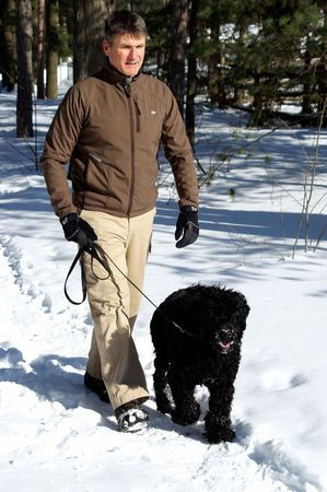 Walking the dog in sunlight provides a daily dose of exercise and vitamin D. photo
