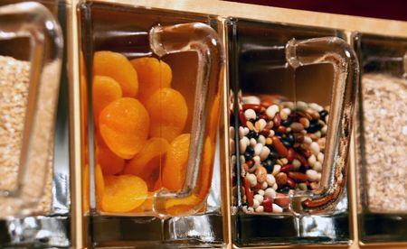 Candy jars for health nuts. Glass jars hold dried fruit, oats and legumes. Stock Photo - 2665161