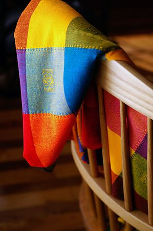 home accents: Mexican cloth woven from colourful fibers draped over a chair. Stock Photo