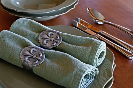 reuseable: Table Setting with a Fleur de Lis theme Stock Photo