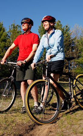 Mountain biking  boomers soak in late afternoon sunlight in Wasaga Beach, Ontario. photo