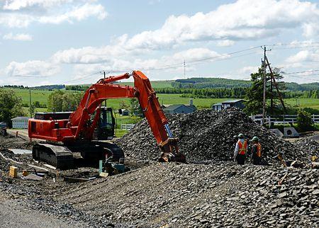 construction crew: Highway construction crew at work in rural Quebec