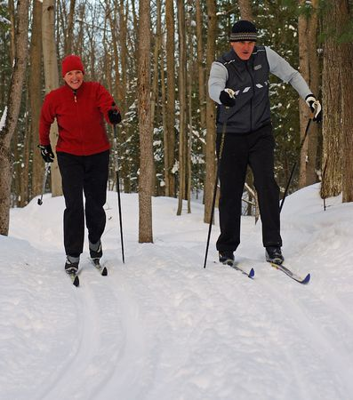 ski track: Couple on Nordic Skis in Canadian Forest