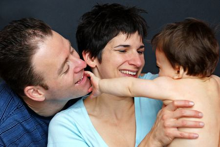 A happy family moment playing with baby boy Stock Photo - 4136768