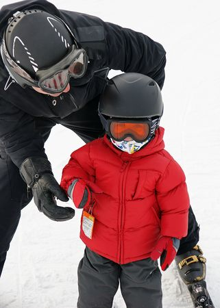 Two year old goes skiing for the first time photo