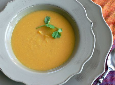 Curried Sweet Potato and Apple soup satisfies an appetite and provides an important source of antioxidants for optimum health and wellness Stock Photo