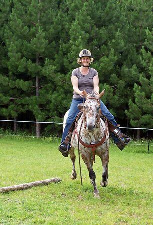 Female rider on an Appaloosa Horse photo