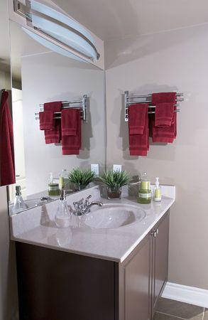 vanity: Sink and vanity in a small condominium bathroom