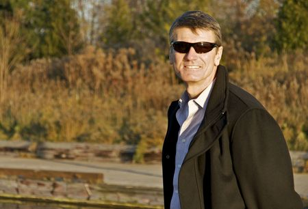 the well groomed: Mature Man with Sunglasses and Overcoat