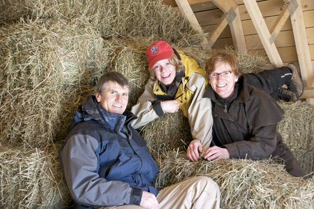 Portrait of a happy family in a hayloft photo