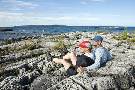 Hikers at Fathom Five National Marine Park take a break to admire the vistas in the UNESCO World Biosphere Reserve. Stock Photo