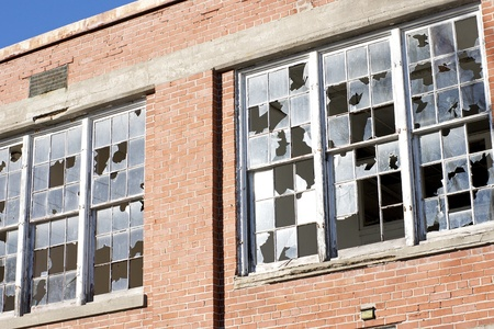 window panes: An abandoned industrial building with broken window panes is a target for mischief makers.