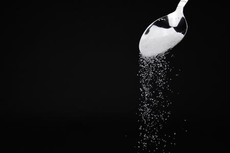 Pouring sugar spoon. Banco de Imagens