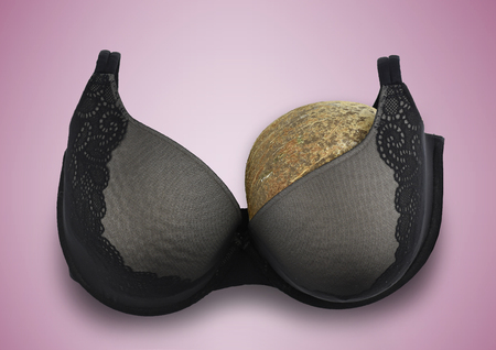One breast breast cancer concept half empty bra after amputation surgery pink background Banco de Imagens