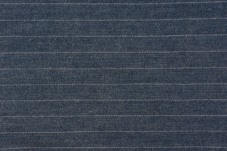 Striped blue denim jeans texture / pattern background. Close up from pants.