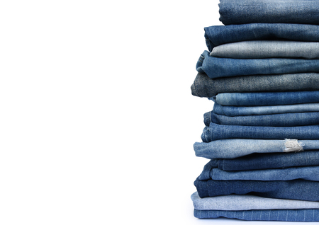 Stack different blue pants, with jeans texture isolated on white background.