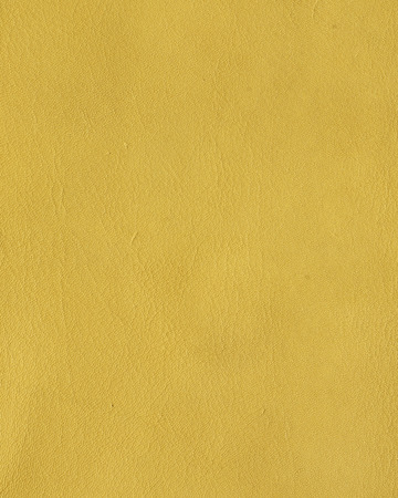 Ocher yellow leather texture background Banco de Imagens