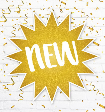 Text label new in golden glitter star with confetti on background sign for new arrivals items Banco de Imagens