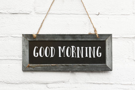 Hello good morning text on long hanging blackboard with wooden frame positive quotes